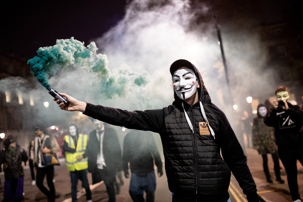Demonstrators take part in the Million Mask March, an anti-capitalist protest organised by Anonymous UK. The march takes place on bonfire night, the anniversary of Guy Fawkes' plot to blow up the Houses of Parliament with gunpowder. November 2018 - London, UK