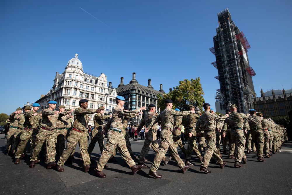 "120 army personnel march down Birdcage Walk, led by the Band of the Grenadier Guards, to a ""welcome home"" reception in the Palace of Westminster, to highlight the breadth of the British Army's current activities. October 2018 - London, UK"