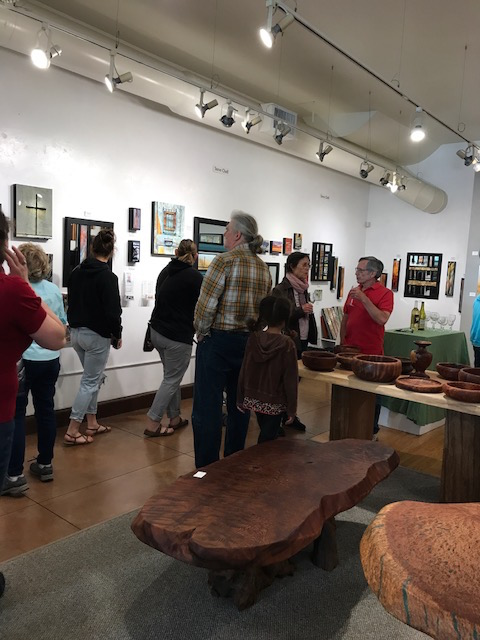 Guests admiring Steve Chell's art, Edgewater's Featured Artist.