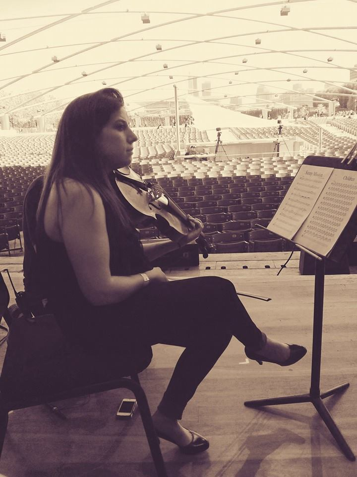 Aimee onstage of the Pritzker Pavilion.