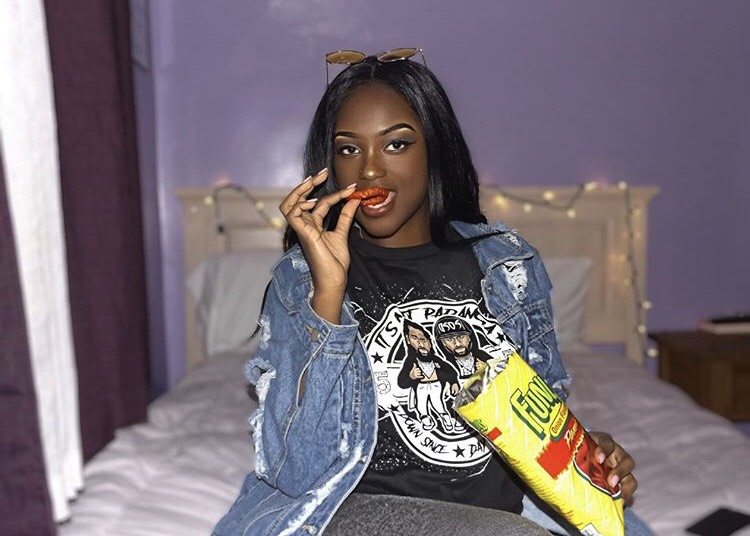 We love a QWEEN that keeps it hood, peep the Flamin Hot Funyuns.