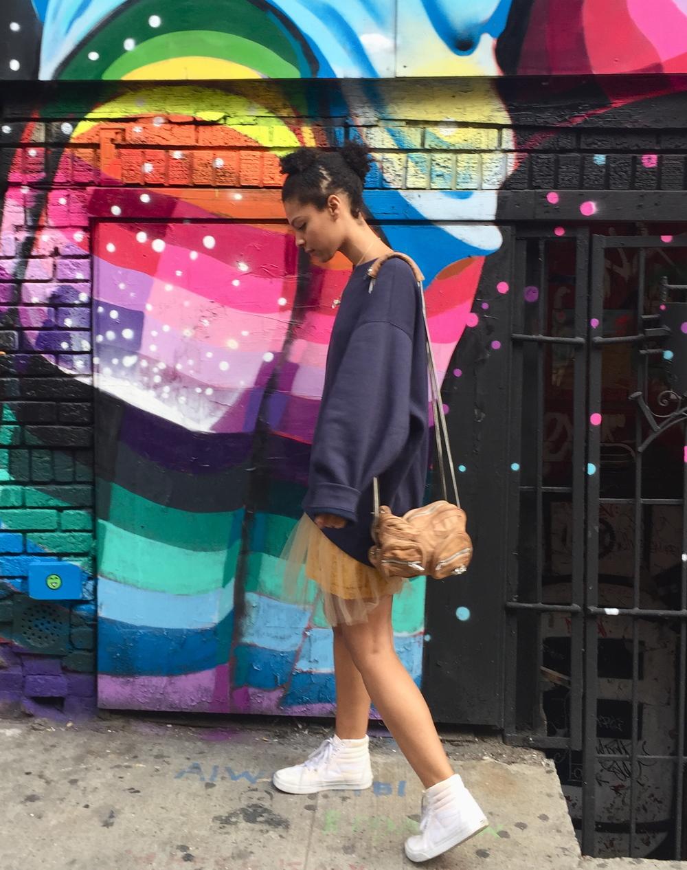 The Style: Acne sweatshirt, Rodarte tulle skirt, white Vanz, Alexander Wang bag, dino hair.