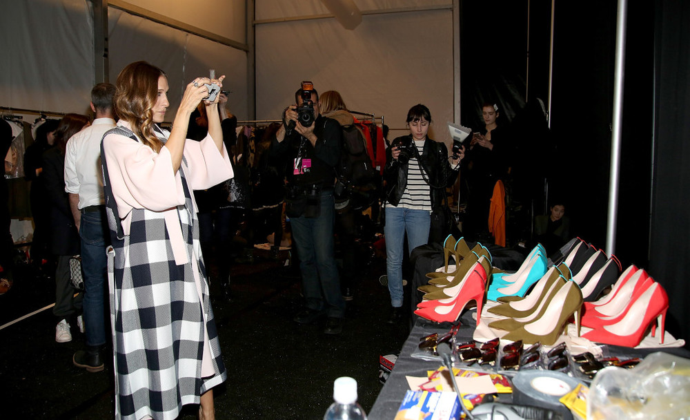 SJP Admiring Her Shoes BackStage