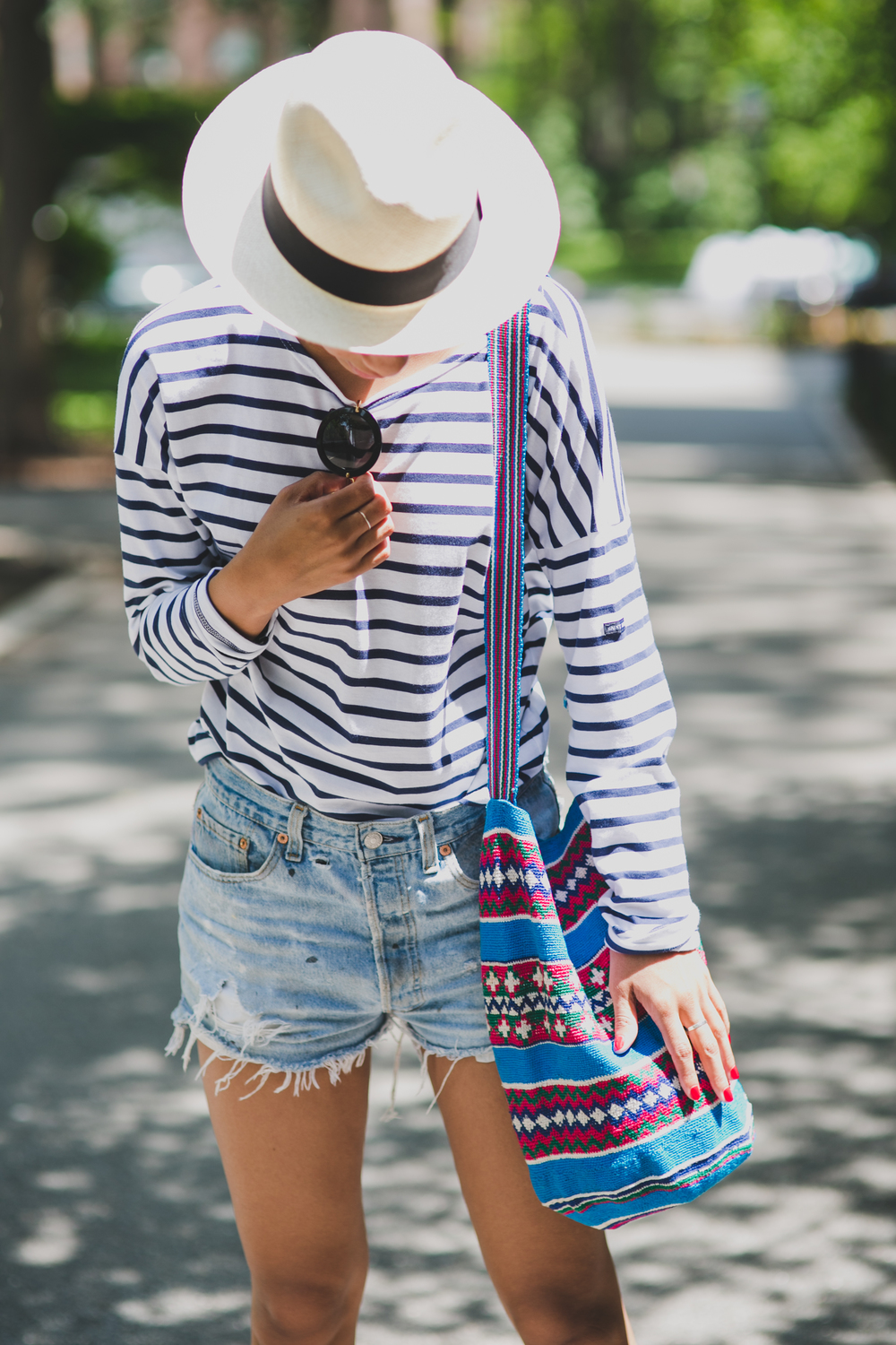 Claire Leana  Millar Wearing J Crew Saint James Stripped Shirt Redone Denim Miu Miu Sunnies J. Crew Hat