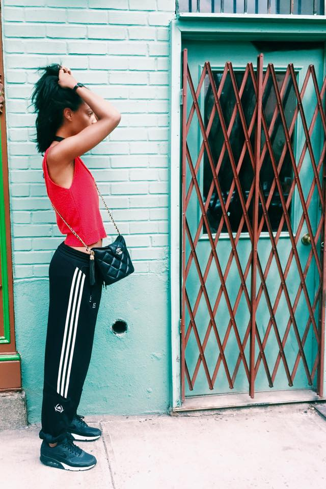 Claire leana Millar wearing adidas track pants and chanel bucket bag in the East Village