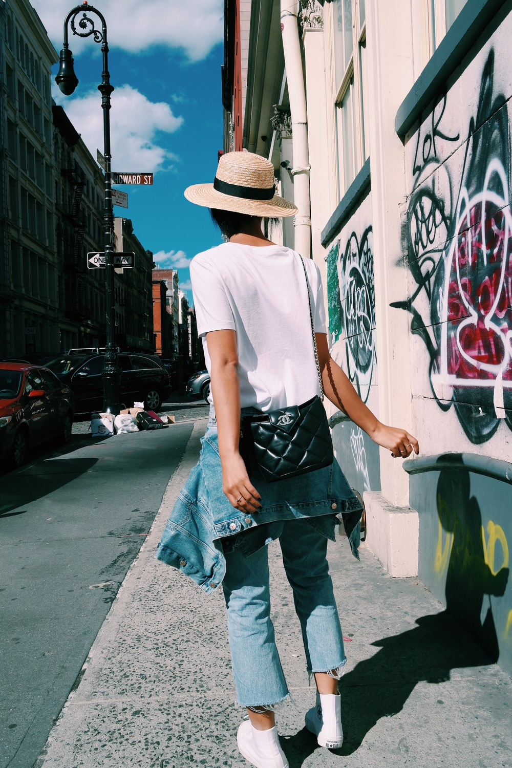 Blogger Claire Leana Millar wearing Lack of Color The Spencer Boater, Acne Studios Tee, ReDone High Waisted Jeans, All White Converse ChuckII & a Vintage Chanel Bag in Soho New York