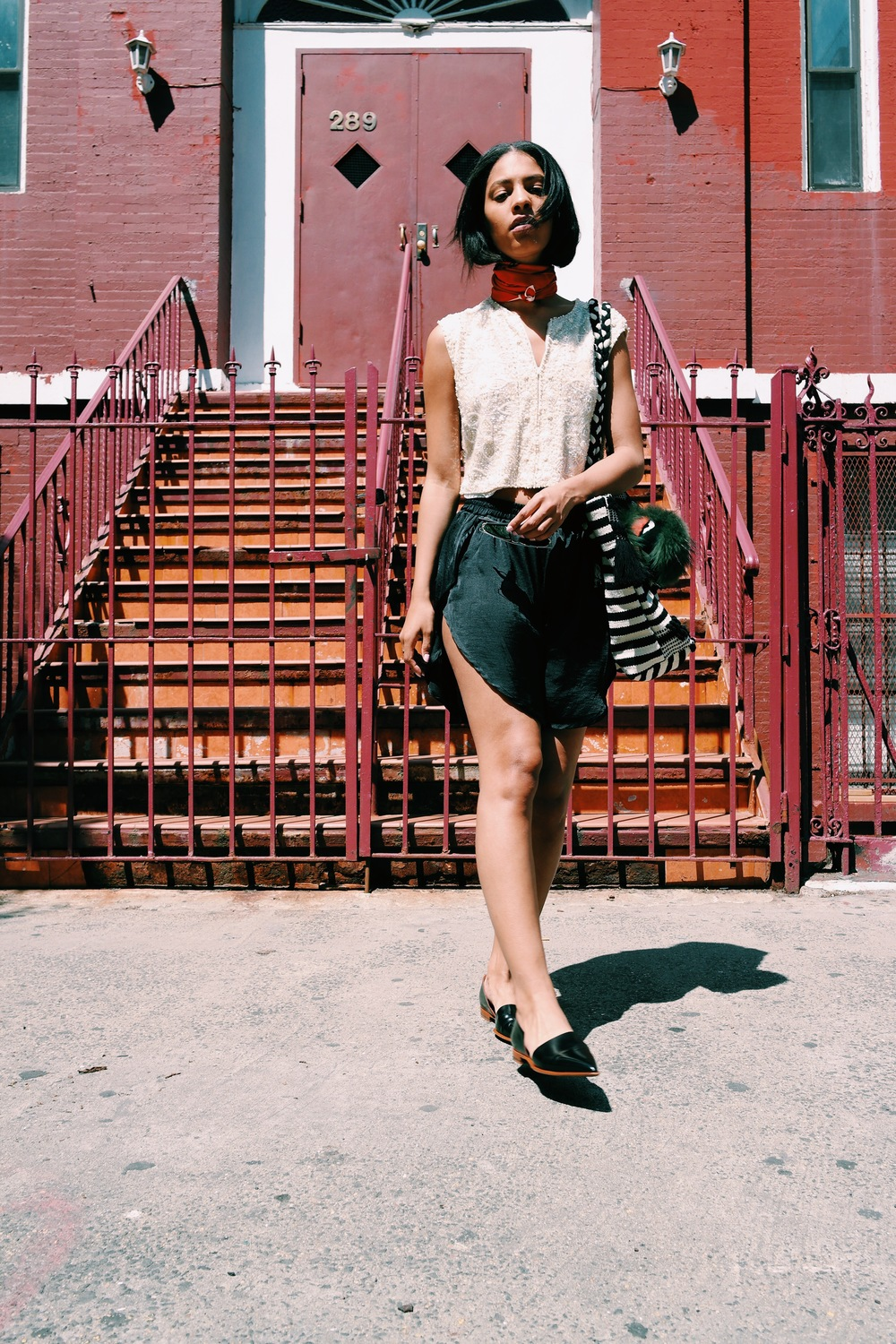 Claire Leana Millar in the East Village Wearing Vintage Sequin Vest, Silke Baseball Shorts, Zara Beach tote, Fendi Bag Bug,