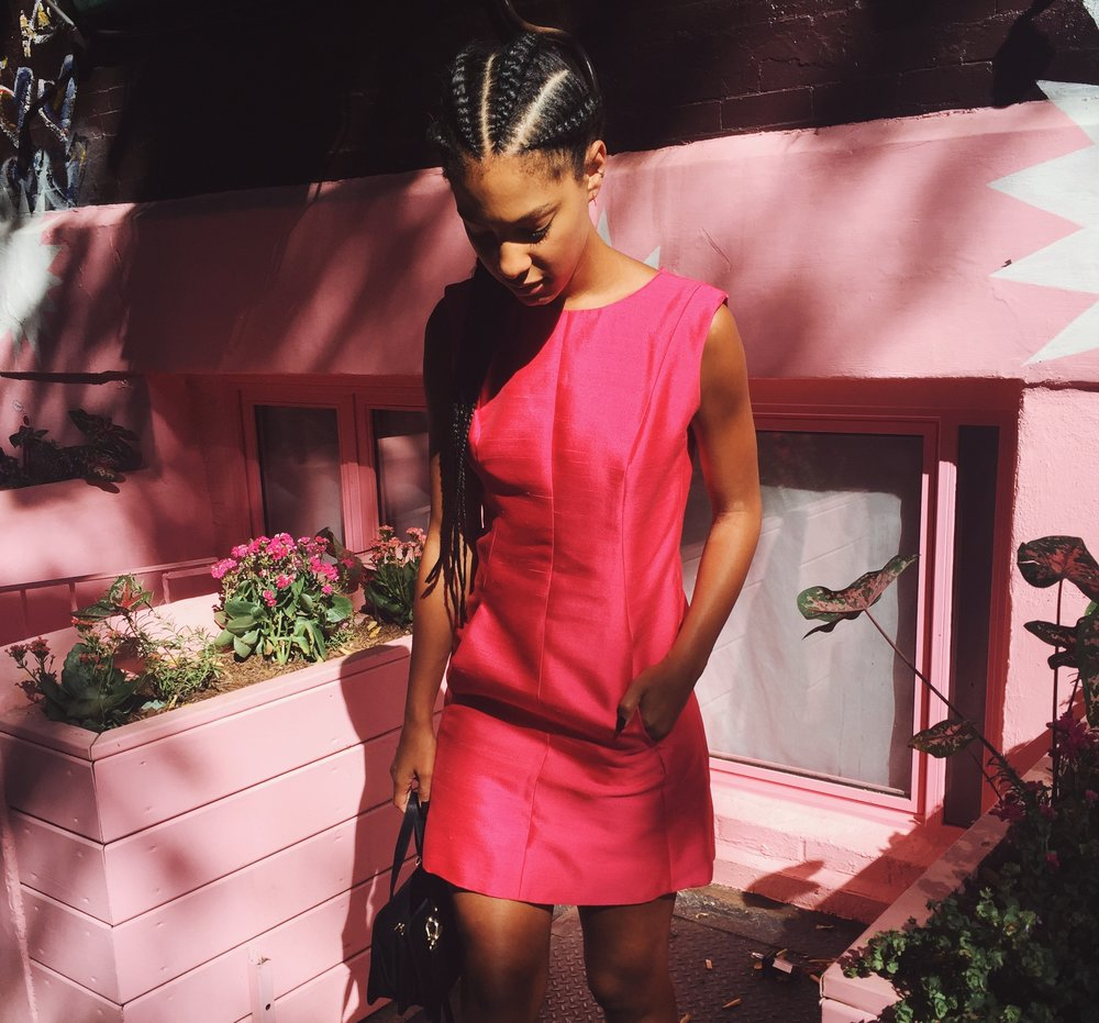 Claire Leana Millar in braids wearing a vintage pink dress and Givenchy Slides at New York Fashion Week SS17