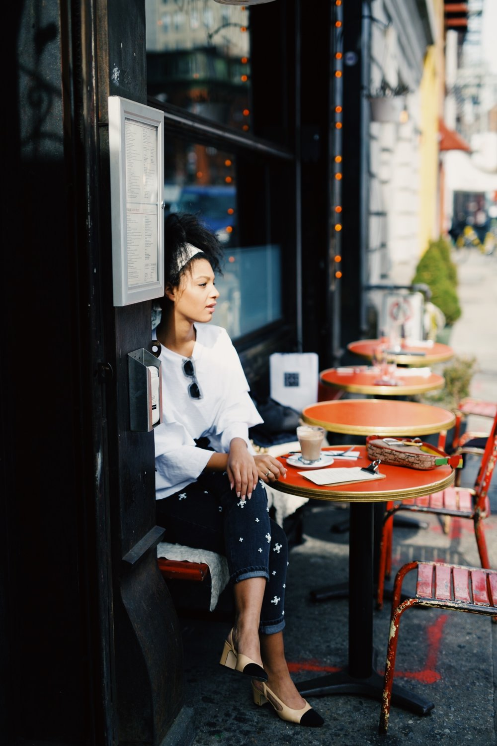 Claire Leana Millar at a Cafe in Soho wearing pearl embellished denim and Chanel Slingbacks