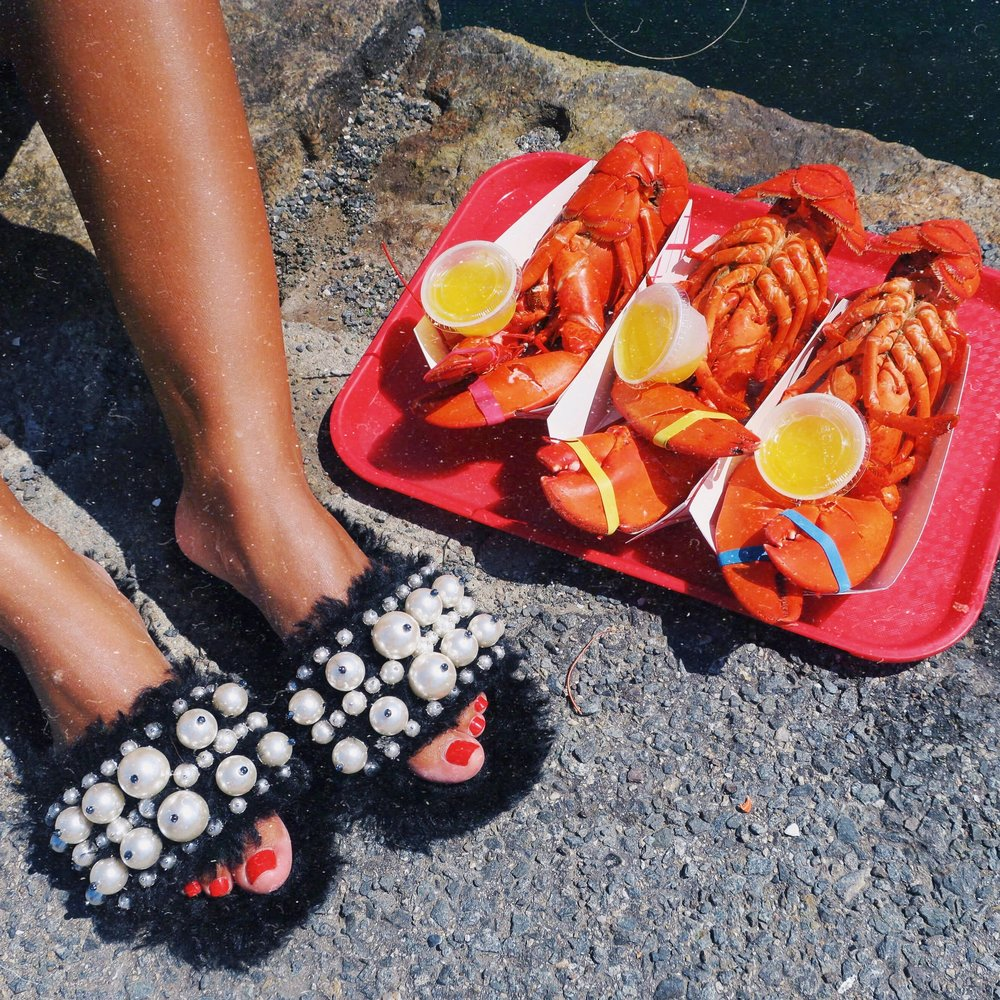 Claire Leana Millar in Miu Miu embellished faux shearling slides having lobster in Rockport Mass
