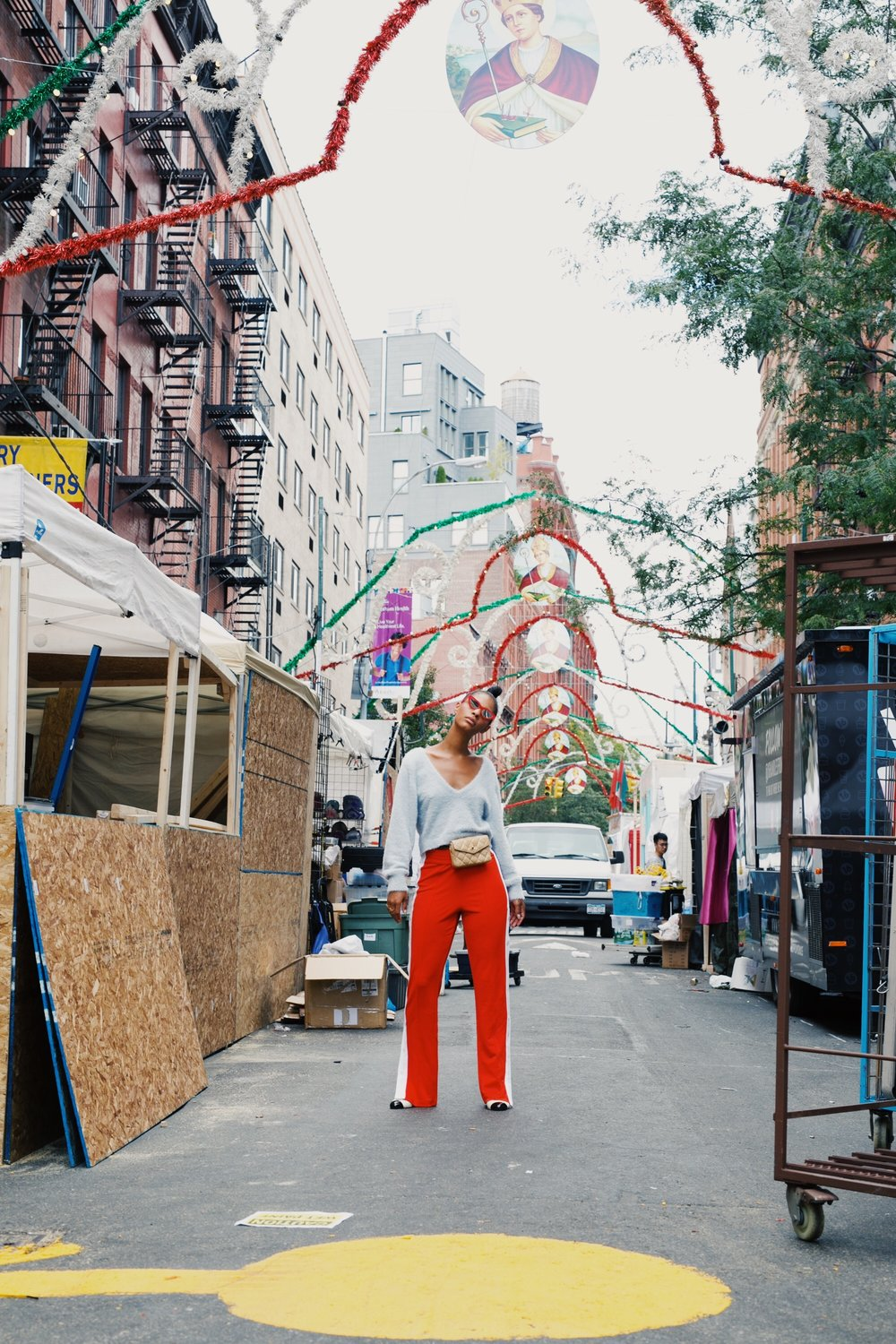 Claire Leana Millar in Nolita NYC wearing H&M Track pants, Chanel Slingbacks, Adam Selman The Last Lolita Sunglasses in Red, and a Vintage Cream Chanel Fanny Pack