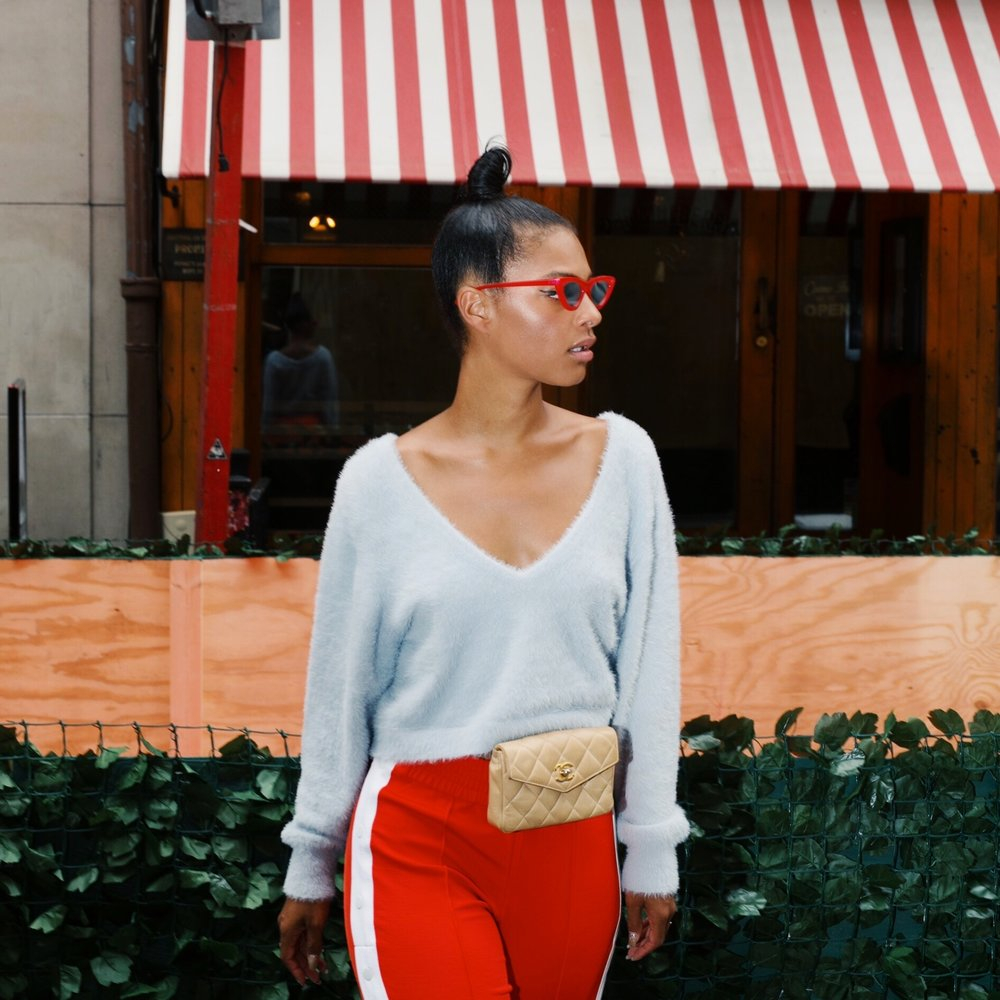 IMG_6742.JPGClaire Leana Millar in Nolita NYC wearing H&M Track pants, Chanel Slingbacks, Adam Selman The Last Lolita Sunglasses in Red, and a Vintage Cream Chanel Fanny Pack