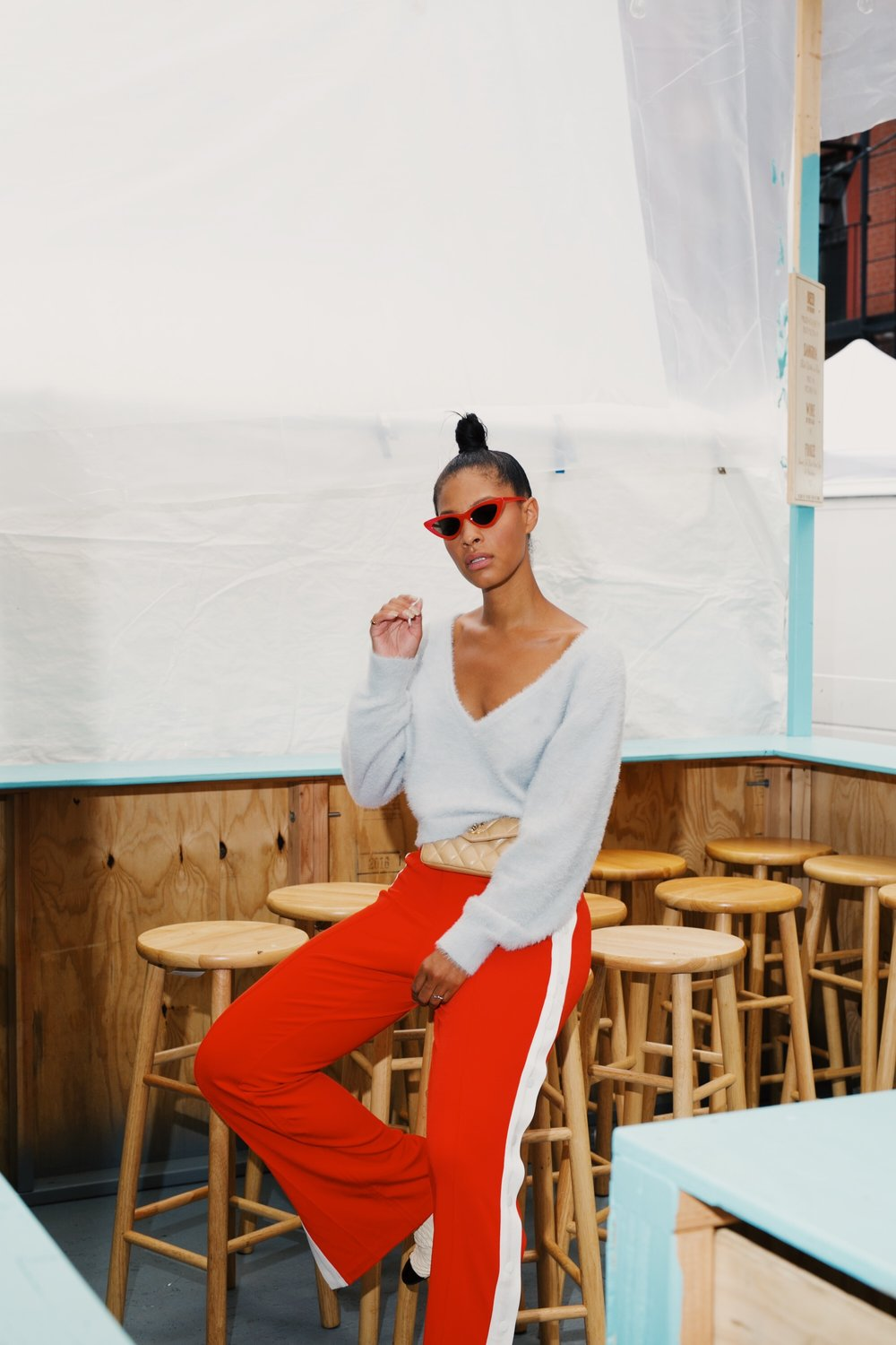 IMG_6767.JPGClaire Leana Millar in Nolita NYC wearing H&M Track pants, Chanel Slingbacks, Adam Selman The Last Lolita Sunglasses in Red, and a Vintage Cream Chanel Fanny Pack