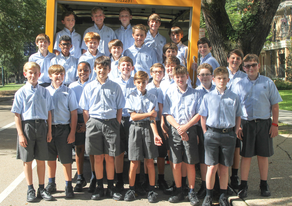 The families of Stuart Hall School for Boys donated 25 large boxes filled with school supplies to help schools affected by the recent flooding in South Louisiana. Seventh grade students (back row) George Martin, Clay Thomas, William Wegmann, Chris Jeansonne, Wesley Adams; (second row) Kelton DuMont, Michael Alan McKenna, Owen Thibodaux, Collin Pelitere, Alton Wise, Ferdie Laudumiey, Joseph Finger; (front row) Charlie McMath, Luke Giroir, William Bruce, Kieran Hendricks, Matthew Knight, Matthew Larrieu, Declan Altikriti, Holden Hess, Nate Jackson, Josh Burk, Aidan Hatch, William Ehrensing, and Patrick Lauscha helped to load the truck with school supplies, which were delivered to Walker Freshman High School in Walker, La.