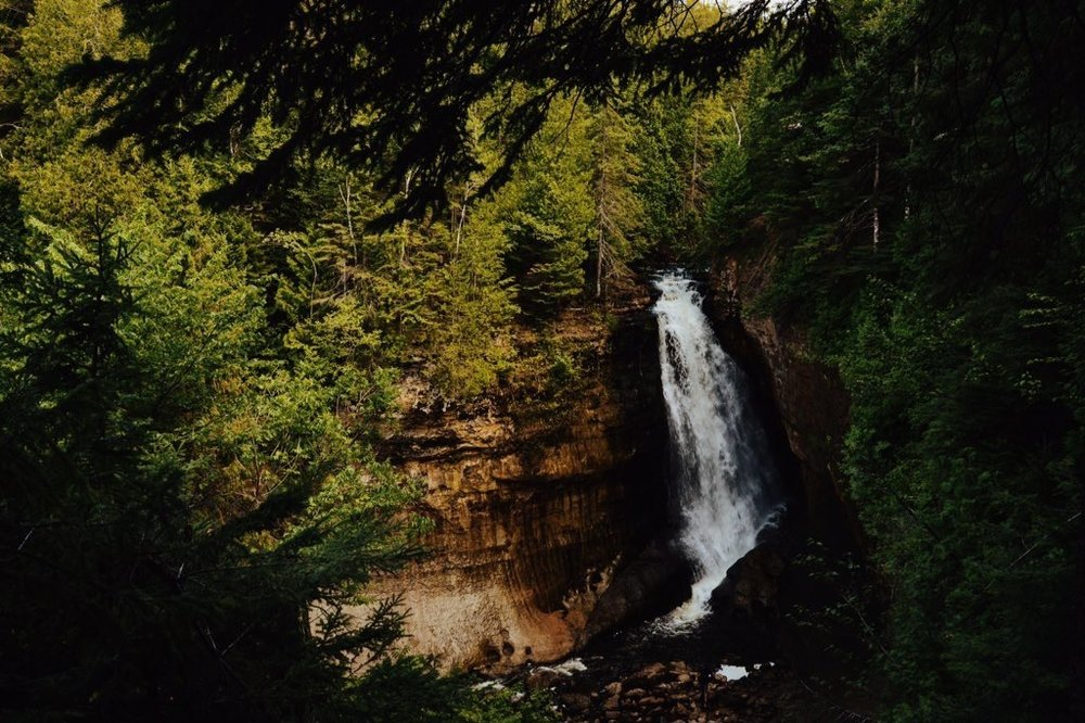 Waterfall located within the woods of Pictured Rocks in the Upper Peninsula, Michigan. We eventually climbed down to the base!