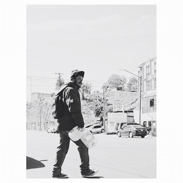 """Walking across the U.S. border checkpoint towards """"El Comedor"""", the immigrant shelter in Nogales, Mexico, we noticed groups of people sleeping under a bridge. From our context, people in this situation are typically homeless. In the context of the Mexican border, this is where immigrants attempting to cross the U.S. border illegally, gather to rest and sleep. No one knows how many days, sometimes weeks someone will be there. Once they get word from the local drug cartel that it's time to cross the border, is when immigrants start their journey, north. What was even more shocking to us is that drug cartels who control this border area, charge immigrants anywhere from $20-$30 a night to sleep under this bridge. Immigrants that sleep under this bridge experience extremely cold nights in the winter and often face very unsafe conditions. Immigrants who can't afford to pay the local cartel to sleep under the bridge, walk to a local cemetery, where among memorials and decorated tombs, they find a place to rest and sleep for the night. #borderstories ——————— Caminando por el puesto de control fronterizo de los Estados Unidos hacia """"El Comedor"""", el refugio de inmigrantes en Nogales, México, notamos a grupos de personas durmiendo bajo un puente. Desde nuestro contexto, las personas en esta situación típicamente no tienen hogar. En el contexto de la frontera, aquí es donde los inmigrantes que intentan cruzar la frontera se reúnen ilegalmente para descansar y dormir. Nadie sabe cuántos días, a veces semanas alguien estará allí, una vez que reciben noticia del cártel local que es hora de cruzar la frontera, es cuando comienzan su viaje, hacia al norte. Lo que fue aún más sorprendente para nosotros es que los cárteles de la droga que controlan esta zona fronteriza, cobran a los inmigrantes entre $20 - $30 por noche para dormir bajo este puente. Los inmigrantes que duermen bajo este puente experimentan, noches extremadamente frías en el invierno y a menudo condiciones muy insegura"""