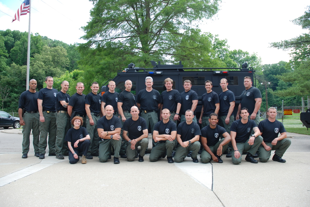Dr. Platoni (Far Left, Kneeling Row) poses with the Dayton SWAT team.
