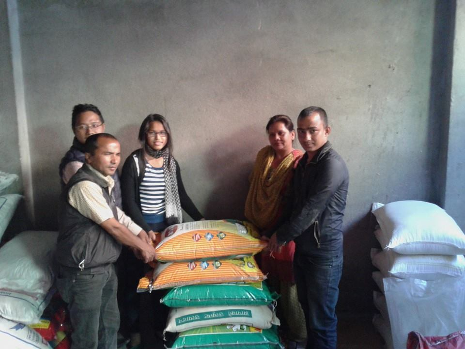 Awon team handing rice sacks to Xpose Nepal