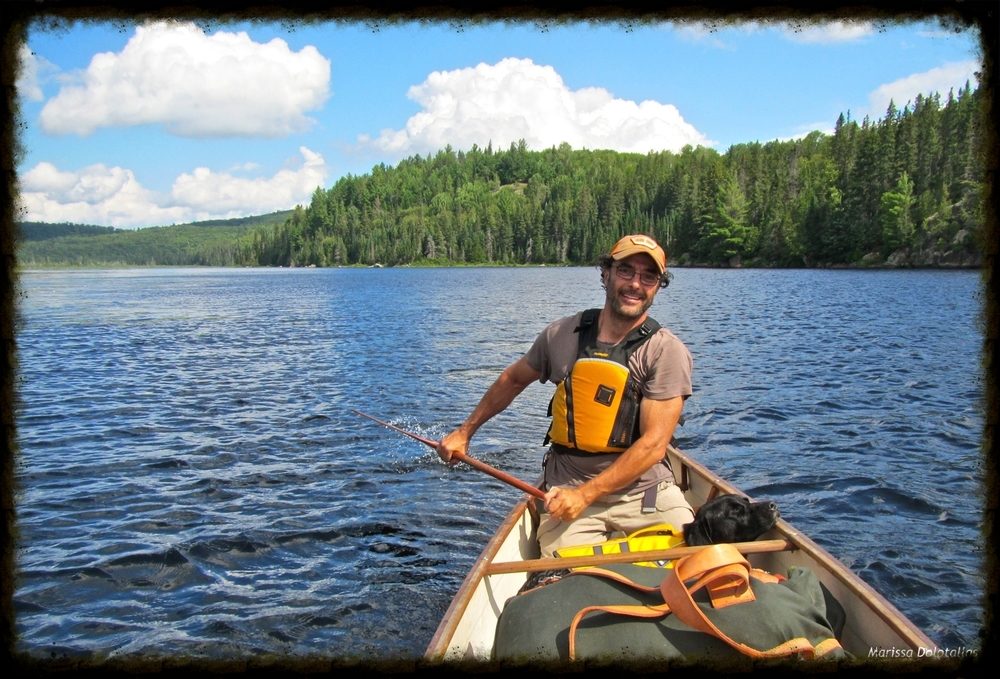 Chris canoe camping with our dog.jpg