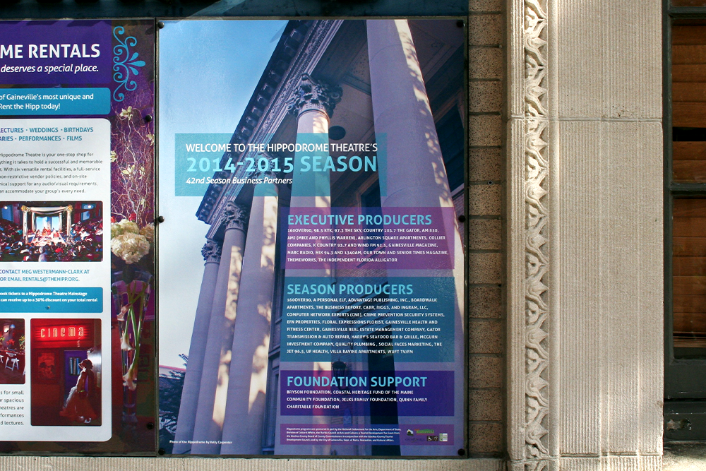 Posters displayed on front wall of the building.