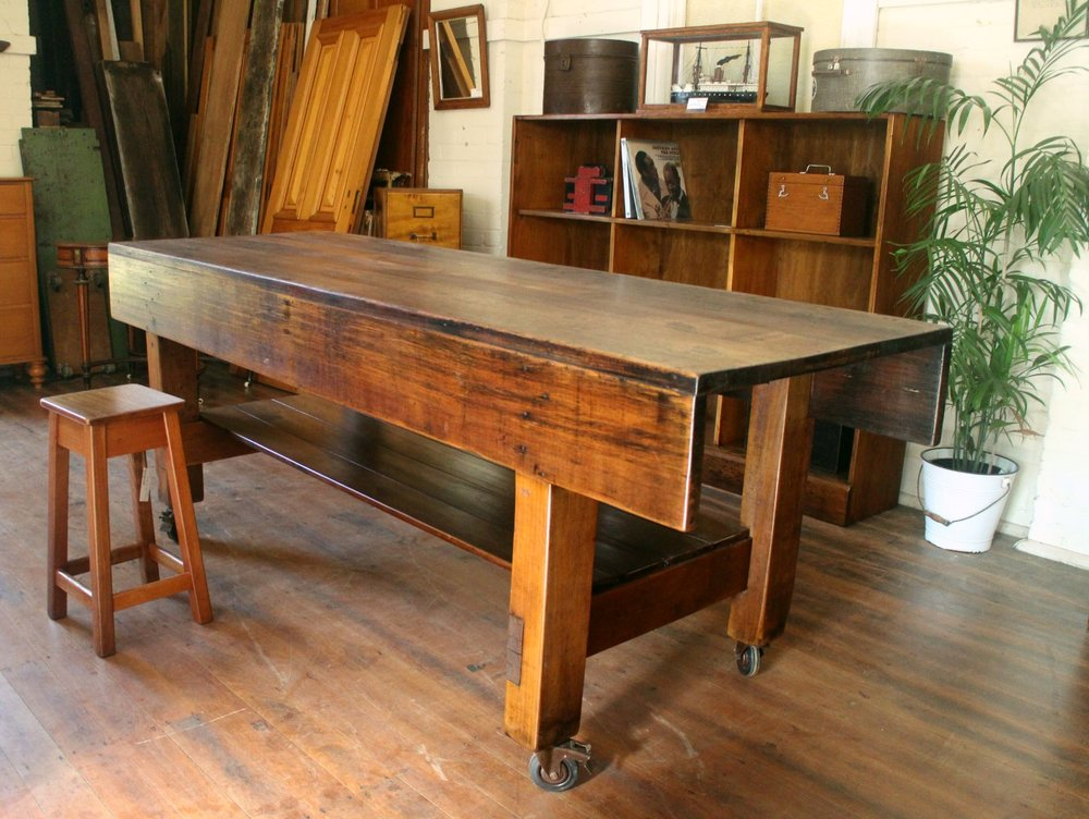 A fantastic Tasmanian Oak & Pine Cabinet Maker's Work Bench dating to the 1930's.  Beautiful age marks throughout and raised on aged lockable castors .  An ideal and unique Kitchen Island Bench .  2440mm x 840mm x 920mm (h)  $7450