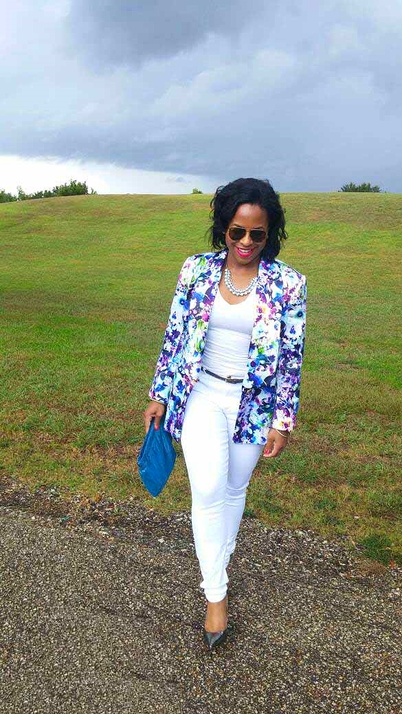 Tossing on this fitted floral jacket pops against a white canvas.