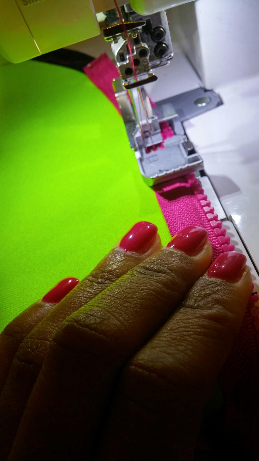 Sewing pink zipper on neoprene dress. 3degreesdb.com