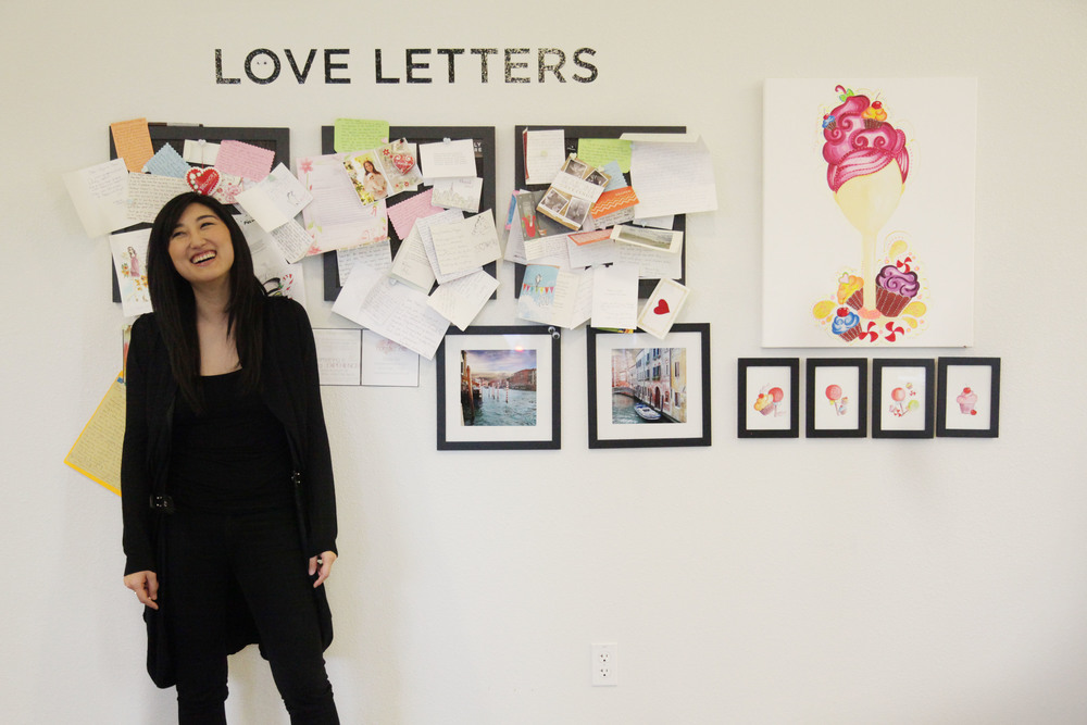 Lee standing by some love letters their users send in