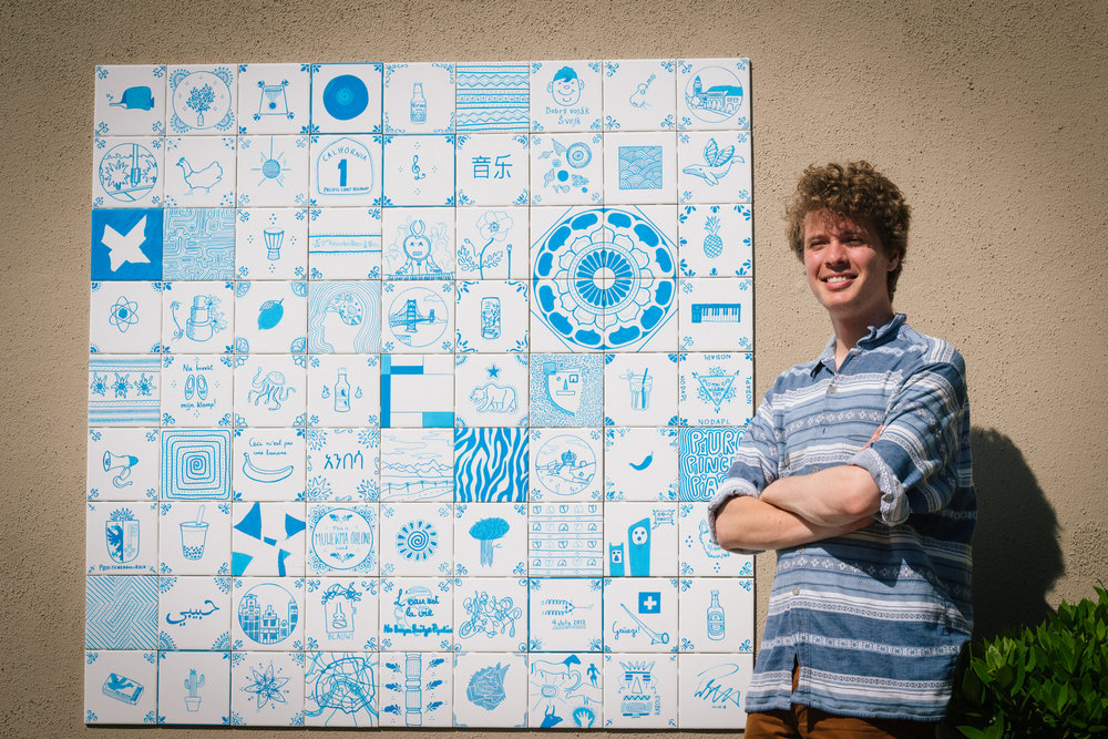 Tegelmmur  by Pieter-Jan Stas  This wall of hand-painted tiles was created in the style of traditional blue and white Dutch Delftware, each tile imagined with a different image, a different story, a different mark of the artist's hand.