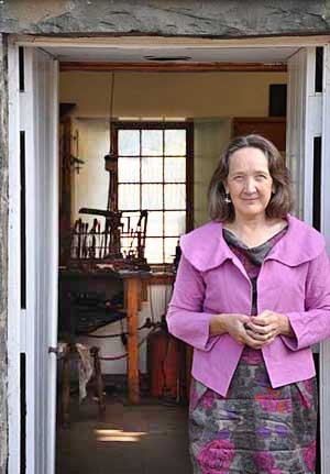 Linda Lewin outside her studio workshop in Stobo, UK