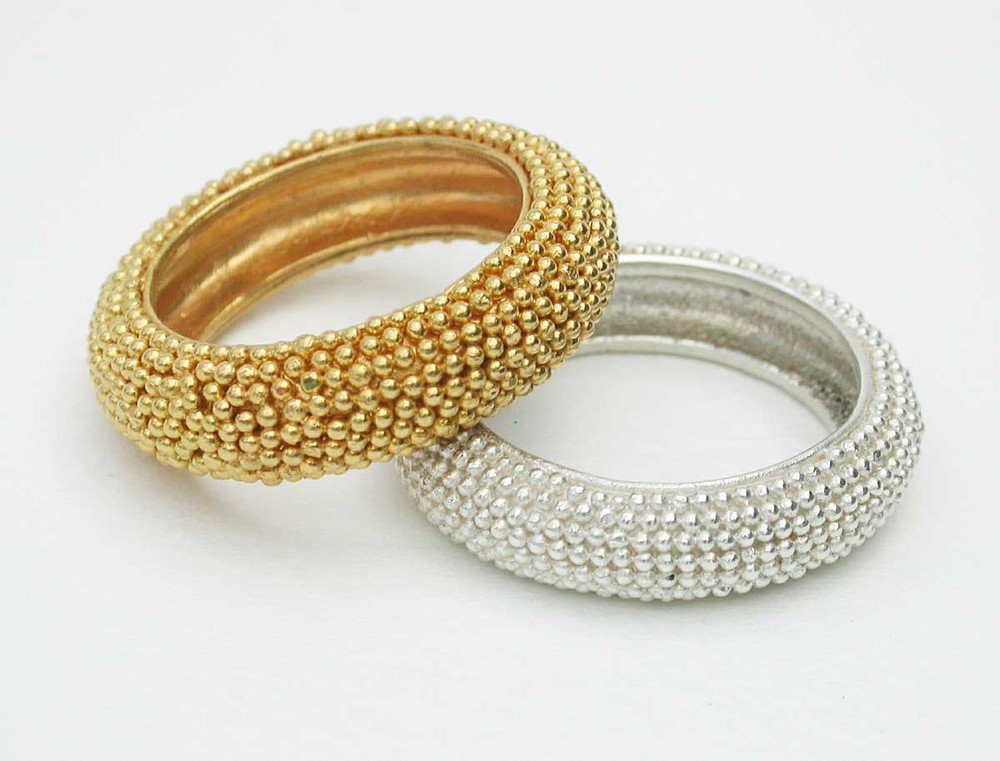 Silver and gold rings