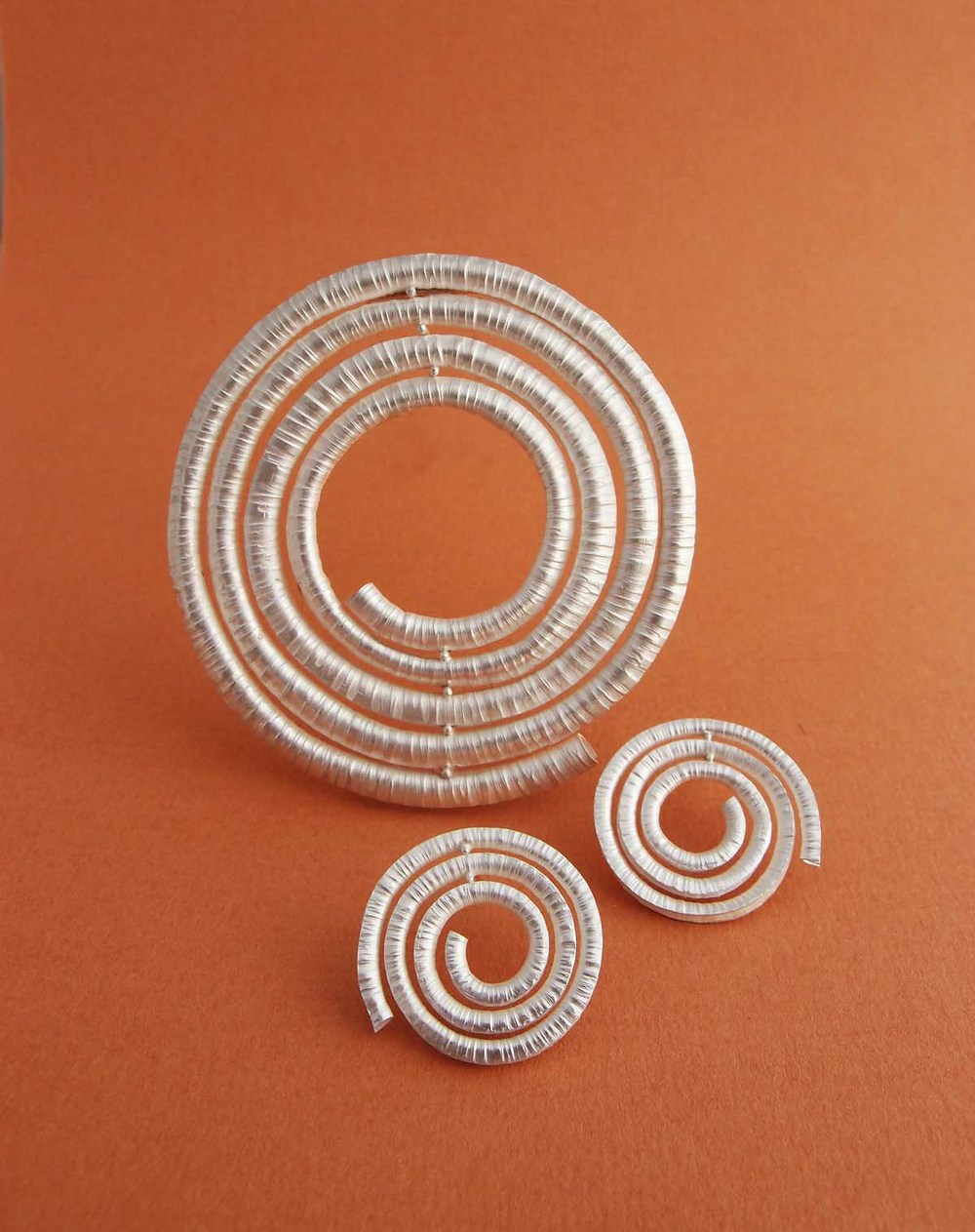 Silver spiral brooch and earrings