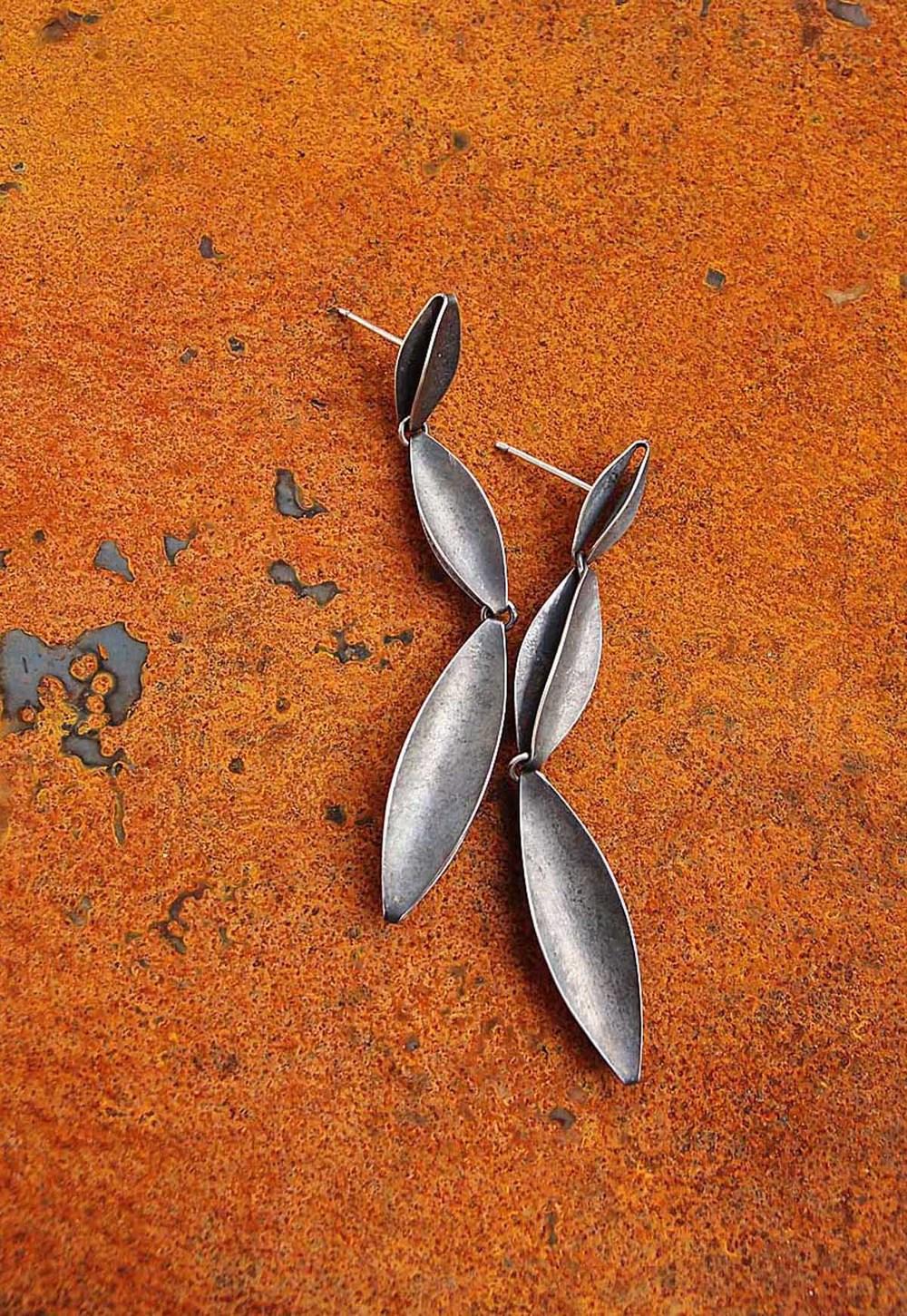 Silver shuttle earrings