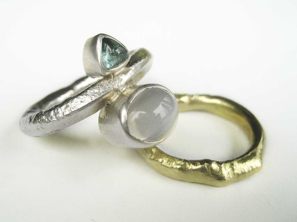 Silver and 18ct. gold rings with moonstone and tourmaline cabochon stones