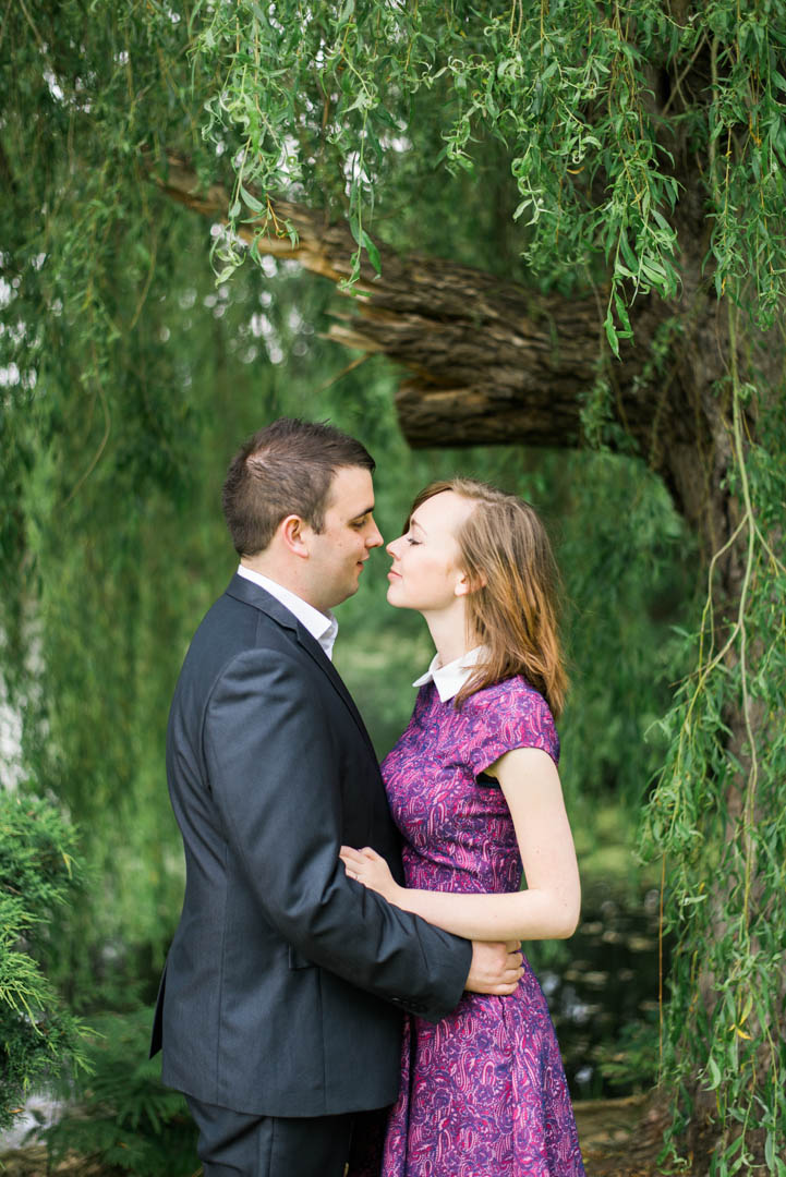 A Young Couple Standing Under A Weeping Willow at Inglewood Manor