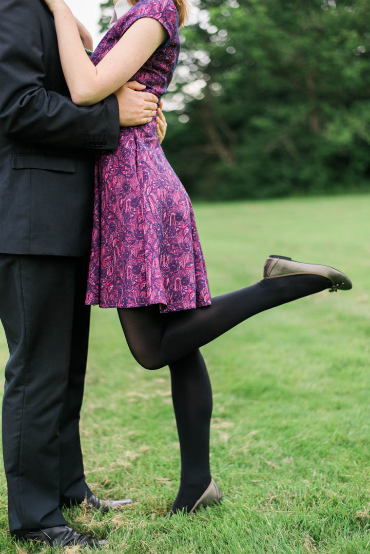 An Engaged Woman Kicks Her Leg Out While Kissing