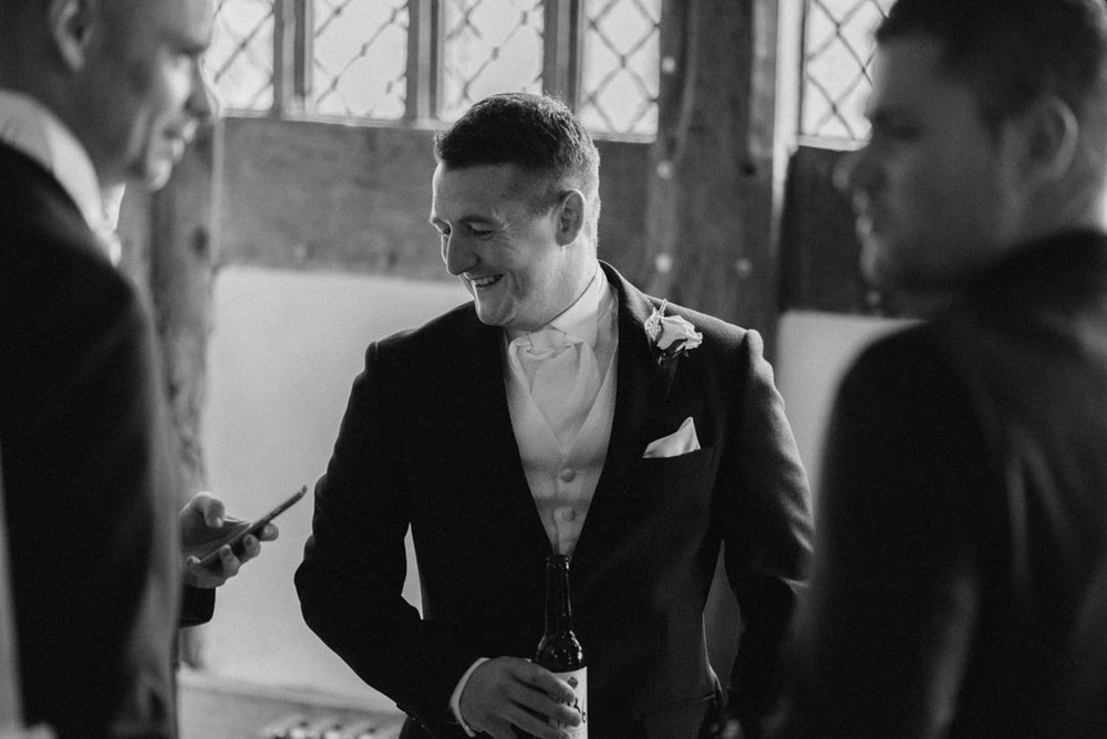 A candid Image of a groomsman at Ordsall Hall Wedding Venue