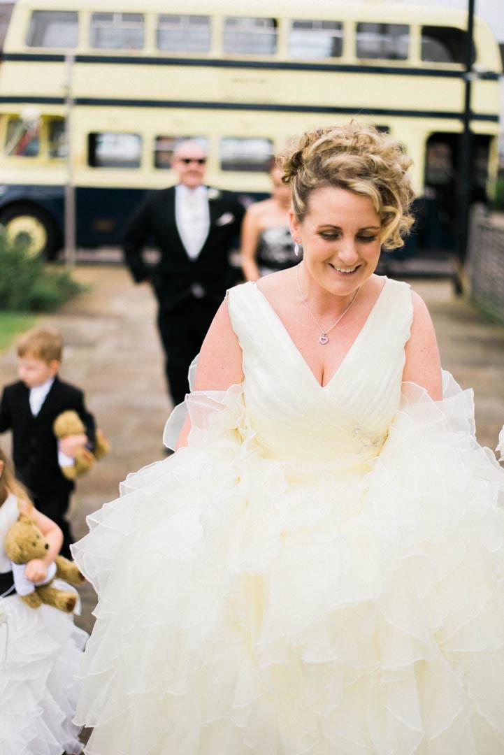 A Happy Bride Arriving at Ordsall Hall Wedding Venue