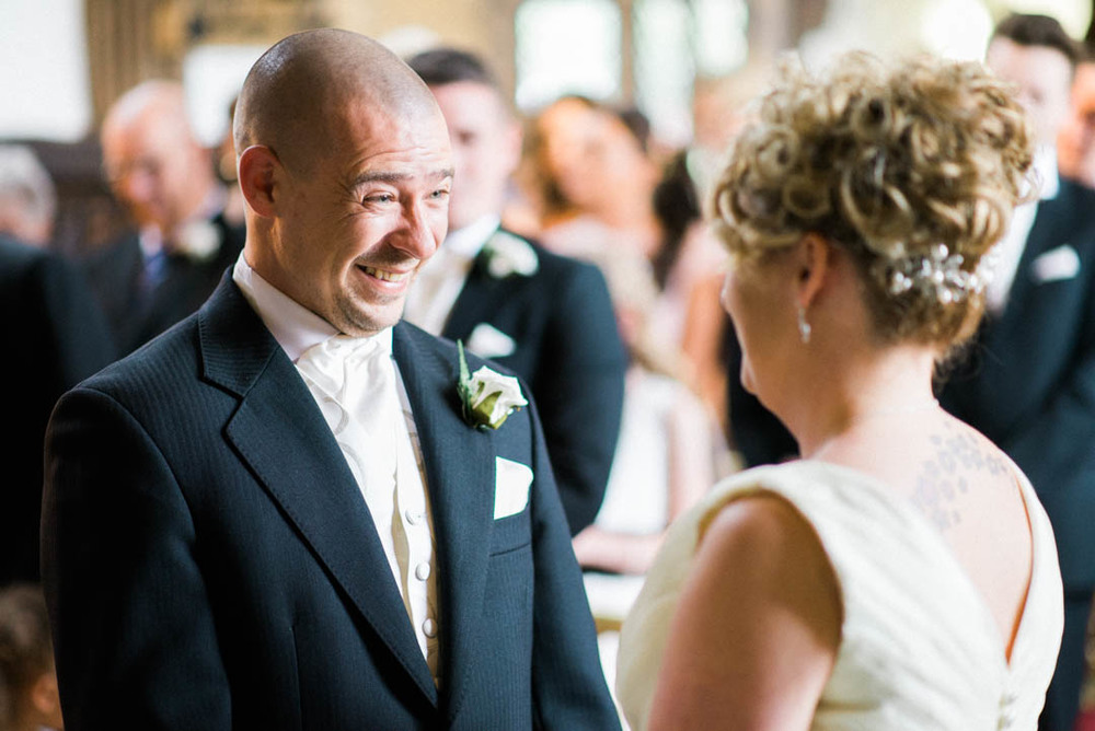 The Bride and Groom Lock eyes for the first time at The Bridesmaids get ready to walk down the Isle at Ordsall Hall Wedding Venue