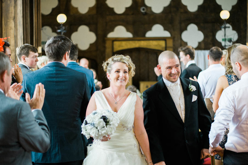 Mr and Mrs walk back town the Isle at Ordsall Hall Wedding Venue