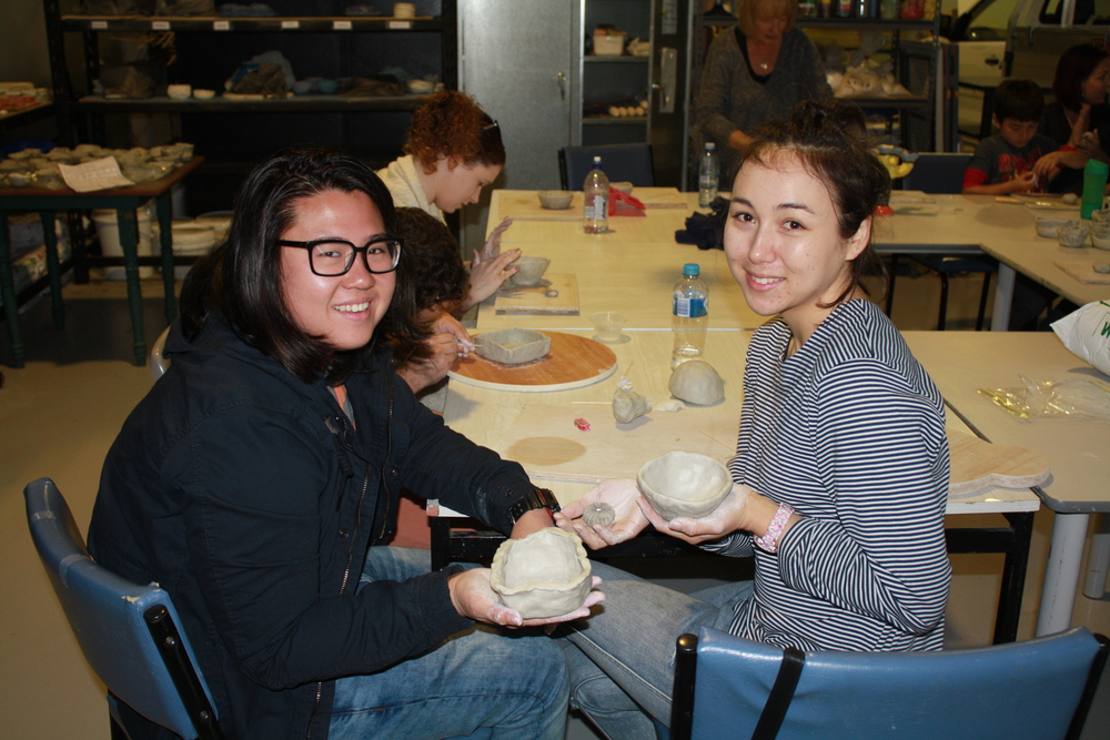Winne Tan and Maria Thomason with their pinch pots.
