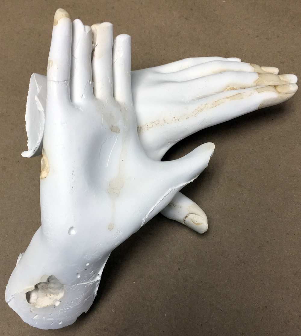 Plaster hands with tobacco stain