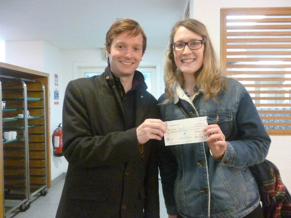 Colin McAvoy from Web Summit Dublin presenting Amy Ryan from Solas Project with a cheque for Solas @ School