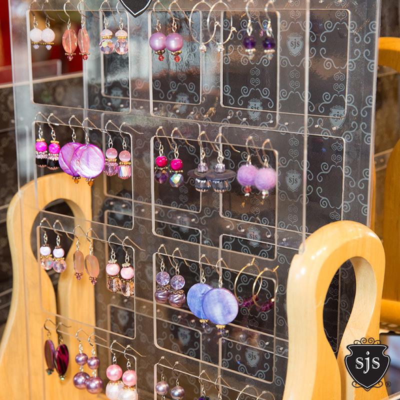 Sparkle earrings purple rack.jpg
