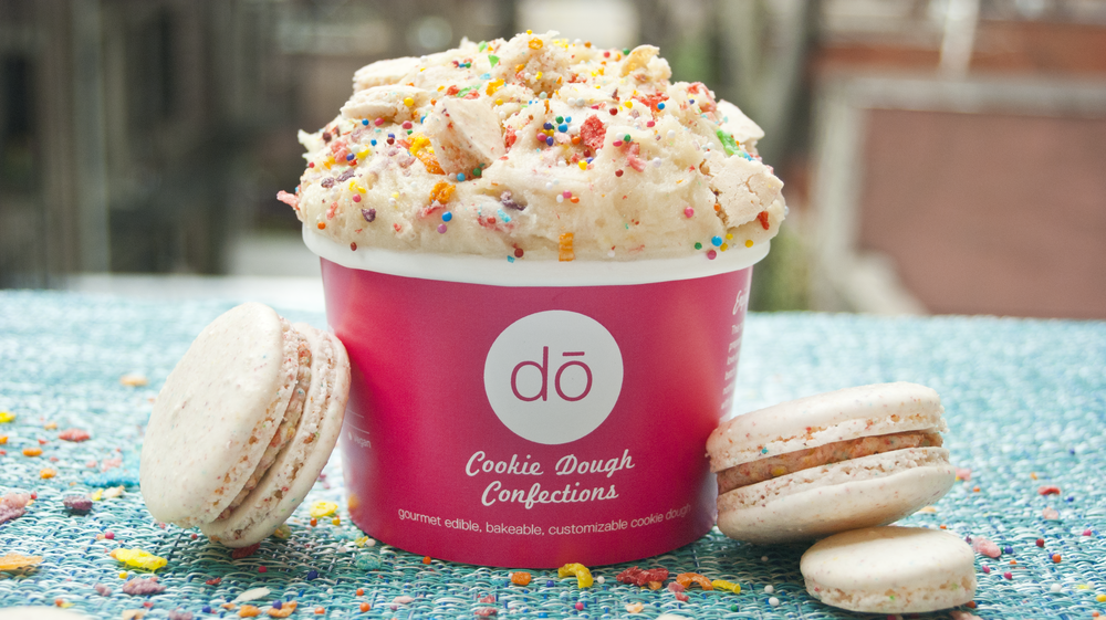 IntroDŌcing our latest obsession: Fruity Mac Attack cookie dough in collaboration with the one and only Macaron mastermind - Dana's Bakery. We've mixed her to-die-for Fruity Cereal Macarons into our Sugar Cookie cookie dough, plus a handful of Fruity Pebbles and enough sprinkles to make everyone smile. It's oh-so yummy AND available in original AND gluten-free! Get it while it lasts - you DŌn't want to miss this one!