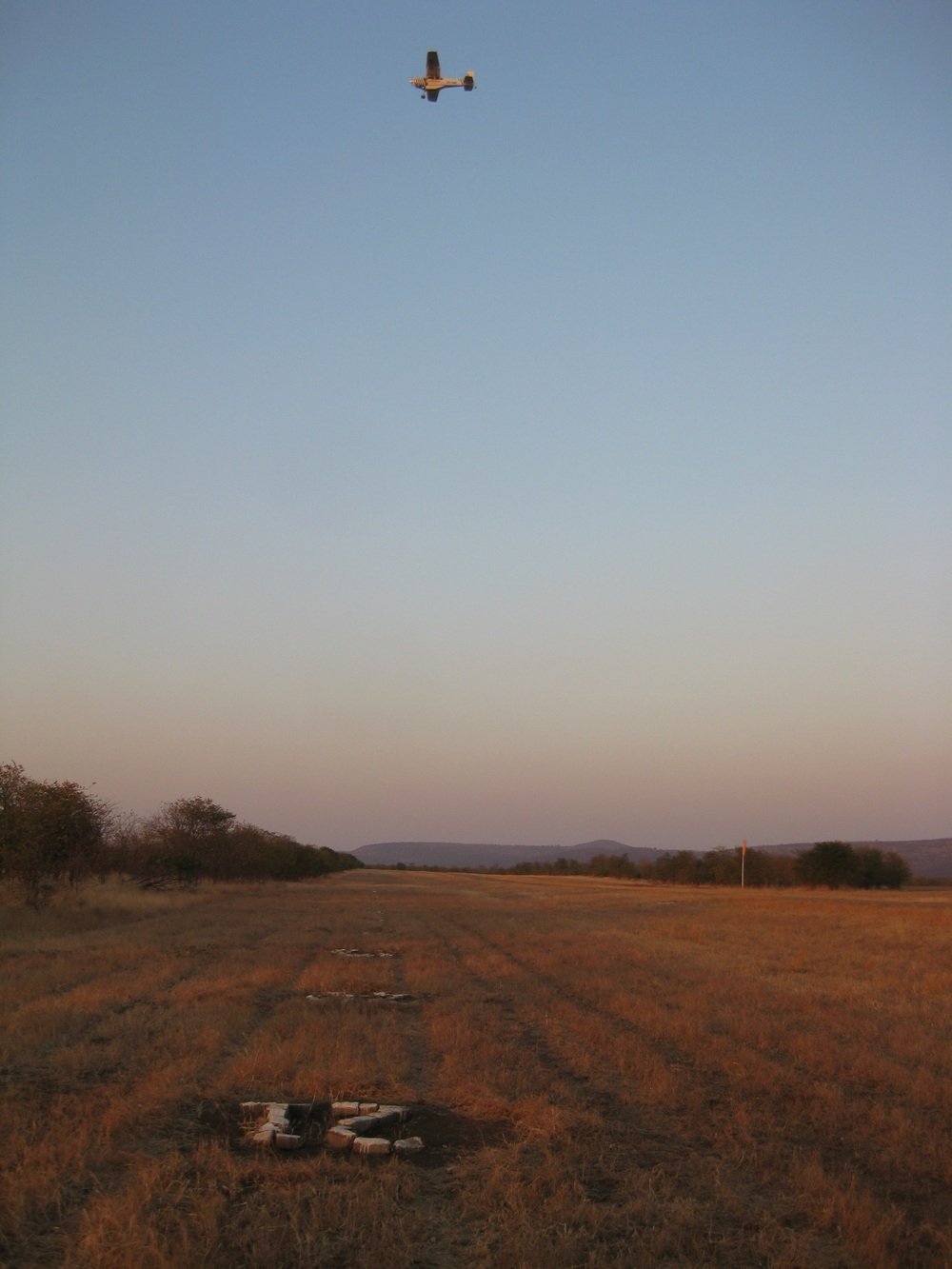 A calibration run at 300 feet above ground level across the airstrip by the survey aircraft. Repeated runs are made to complete the calibration.  Chipinda Pools, August 2014 .
