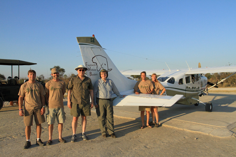 Members of the Elephants Without Borders team, including Kelly Landen, far right, Dr. Mike Chase, second from right, show off their new plane to Paul Allen and Vulcan Inc.'s Bert Kolde, third from left.