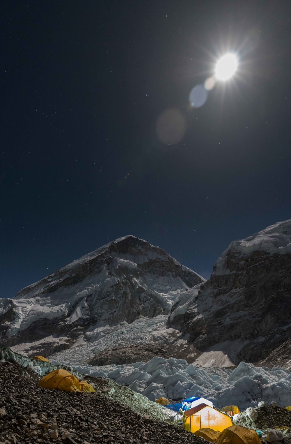 Everest Base Camp at night with the West Shoulder of Sagarmāthā in the distance