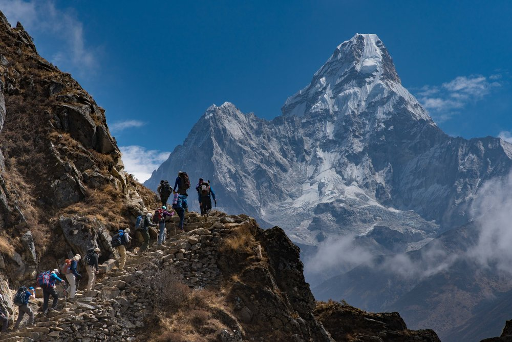 The team overshadowed by Ama Dablam