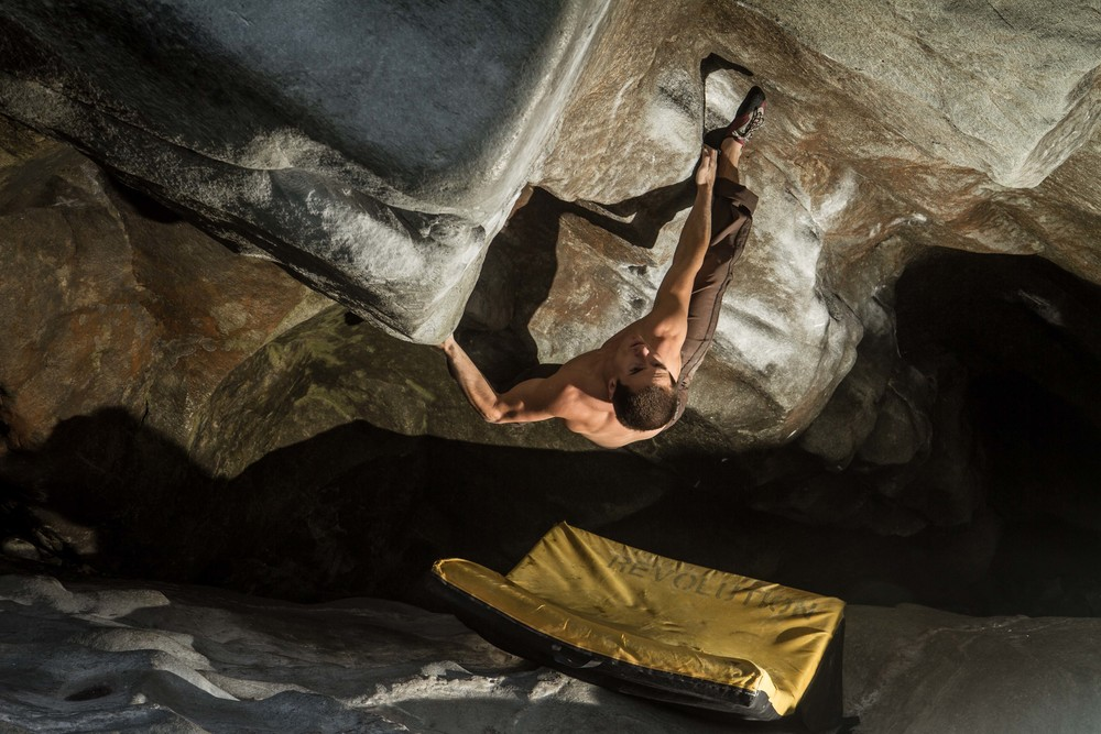 Revolution Athlete Carlo Traversi climbing The Neverending Story V14 in Magic Wood, Switzerland over a Mission Pad.